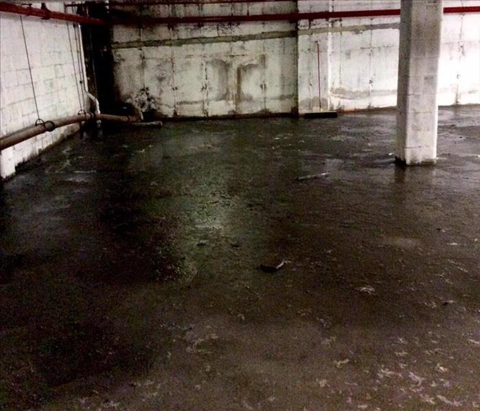 Sewer Backup in Staten Island Commercial Basement Before